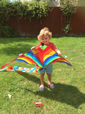Proudly holding his kite